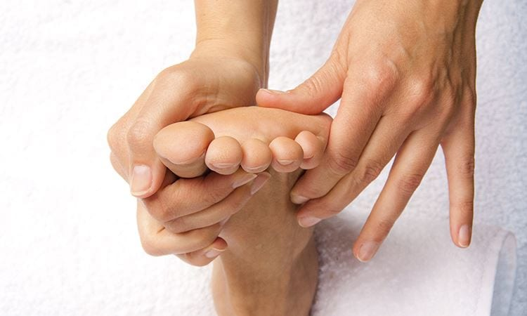 hands giving reflexology treatment