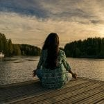 girl sitting on dock meditating Reflexology Healing Medfield MA