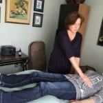 woman in blue put hands on gray shirt Reflexology Healing Medfield MA